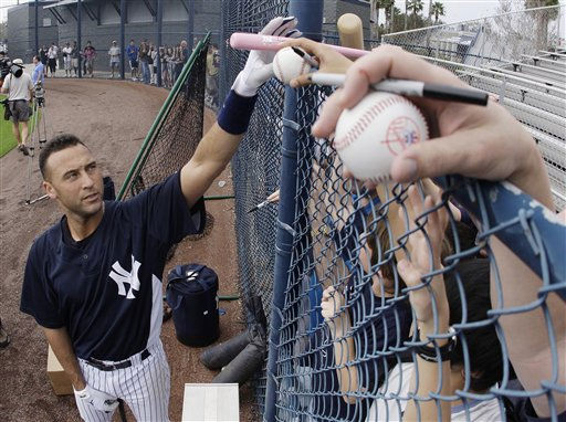 New York Yankees&#39; Derek Jeter, left, signs autographs for fans during spring training baseball workouts Sunday, Feb. 24, 2008, in Tampa, Fla. &#40;AP Photo&#47;Julie Jacobson&#41; <span class=meta>(AP Photo&#47; Julie Jacobson)</span>