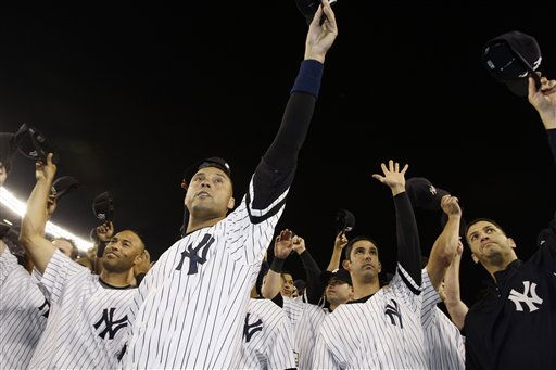 New York Yankees&#39; Derek Jeter, front, Mariano Rivera, left, and Jorge Posada, second from right, join teammates in saluting fans after the Yankees beat the Baltimores Orioles 7-3 in what was likely the final baseball game at Yankee Stadium, in New York on Sunday, Sept. 21, 2008. &#40;AP Photo&#47;Kathy Willens&#41; <span class=meta>(AP Photo&#47; Kathy Willens)</span>