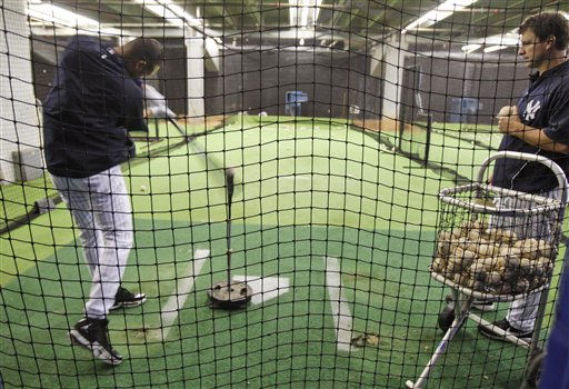 New York Yankees guest spring training instructor Tino Martinez, right, watches Derek Jeter take batting practice off a tee in the batting cages on his day off at Steinbrenner Field in Tampa, Fla., Tuesday, March 31, 2009.  Several position players stayed back as the team played the Cincinnati Reds in Sarasota. &#40;AP Photo&#47;Kathy Willens&#41; <span class=meta>(AP Photo&#47; Kathy Willens)</span>