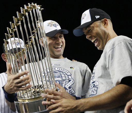 "<div class=""meta ""><span class=""caption-text "">New York Yankees' Derek Jeter, left, and Mariano Rivera look at the championship trophy after winning the Major League Baseball World Series against the Philadelphia Phillies Wednesday, Nov. 4, 2009, in New York. (AP Photo/David J. Phillip) (AP Photo/ David J. Phillip)</span></div>"