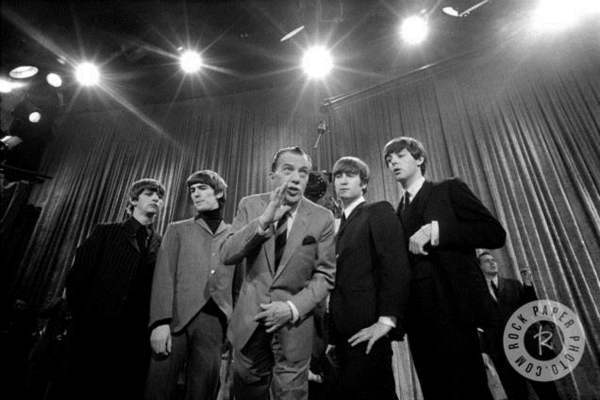 In this Feb. 9, 1964 file photo, Ed Sullivan, center, stands with The Beatles during a rehearsal for the British group&#39;s first American appearance, on the &#34;Ed Sullivan Show,&#34; in New York. From left: Ringo Starr, George Harrison, Sullivan, John Lennon and Paul McCartney.  <span class=meta>(Photo from the AP Collection Courtesy of Rock Paper Photo)</span>