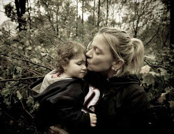"<div class=""meta image-caption""><div class=""origin-logo origin-image ""><span></span></div><span class=""caption-text"">Consoling Lucy After Sandy Destroyed Her Backyard Toys.</span></div>"