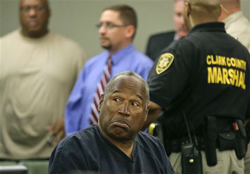 "<div class=""meta image-caption""><div class=""origin-logo origin-image ""><span></span></div><span class=""caption-text"">O.J. Simpson listens to testimony at an evidentiary hearing in Clark County District Court, Monday, May 13, 2013 in Las Vegas. Simpson, who is currently serving a nine-to-33-year sentence in state prison as a result of his October 2008 conviction on armed robbery and kidnapping charges, is seeking a new trial, claiming that trial lawyer Yale Galanter had conflicted interests and shouldn't have handled Simpson's armed case. (AP Photo/Julie Jacobson, Pool) (AP Photo/ Julie Jacobson)</span></div>"