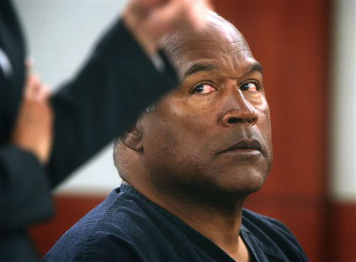 O.J. Simpson listens to his attorney Patricia Palm in court at Clark County Regional Justice Center, Monday, May 13, 2013 in Las Vegas. Simpson, who is currently serving a nine-to-33-year sentence in state prison as a result of his October 2008 conviction on armed robbery and kidnapping charges, is seeking a new trial, claiming that trial lawyer Yale Galanter had conflicted interests and shouldn&#39;t have handled Simpson&#39;s armed case. &#40;AP Photo&#47;Las Vegas Review-Journal, Jeff Scheid, Pool&#41; <span class=meta>(AP Photo&#47; Jeff Scheid)</span>