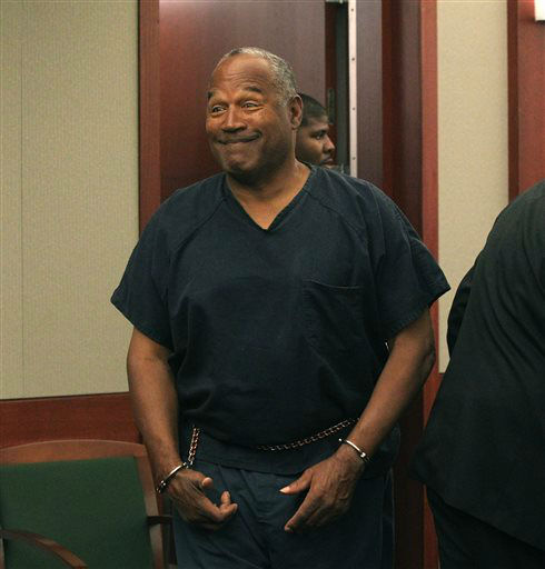 O.J. Simpson appears at Clark County Regional Justice Center in Las Vegas, Monday, May 13, 2013. Simpson, who is currently serving a nine-to-33-year sentence in state prison as a result of his October 2008 conviction on armed robbery and kidnapping charges, is seeking a new trial, claiming that trial lawyer Yale Galanter had conflicted interests and shouldn&#39;t have handled Simpson&#39;s armed case. &#40;AP Photo&#47;Las Vegas Review-Journal, Jeff Scheid, Pool&#41; <span class=meta>(AP Photo&#47; Jeff Scheid)</span>