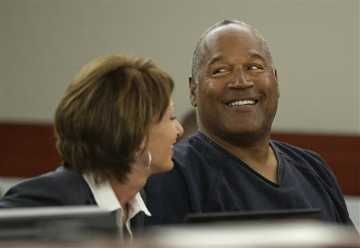 O.J. Simpson, right, talks with his attorney, Patricia Palm in Clark County District Court, Monday, May 13, 2013 in Las Vegas. Simpson, who is currently serving a nine-to-33-year sentence in state prison as a result of his October 2008 conviction on armed robbery and kidnapping charges, is seeking a new trial, claiming that trial lawyer Yale Galanter had conflicted interests and shouldn&#39;t have handled Simpson&#39;s armed case. &#40;AP Photo&#47;Julie Jacobson, Pool&#41; <span class=meta>(AP Photo&#47; Julie Jacobson)</span>
