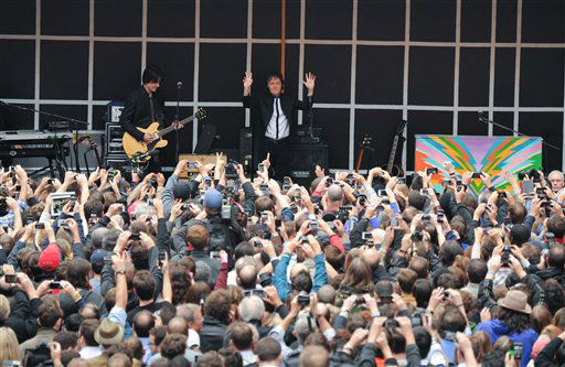 "<div class=""meta ""><span class=""caption-text "">Sir Paul McCartney and his band give a surprise pop up concert in Times Square on Thursday, Oct. 10, 2013 in New York. McCartney will release his new album called ""New"" on October 15th. (Photo by Evan Agostini/Invision/AP)   (Photo/Evan Agostini)</span></div>"