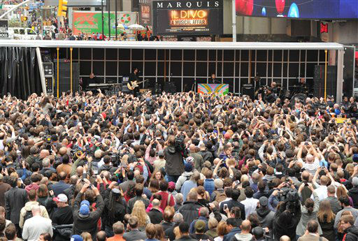 Sir Paul McCartney and his band give a surprise pop up concert in Times Square on Thursday, Oct. 10, 2013 in New York. McCartney will release his new album called &#34;New&#34; on October 15th. &#40;Photo by Evan Agostini&#47;Invision&#47;AP&#41;   <span class=meta>(Photo&#47;Evan Agostini)</span>