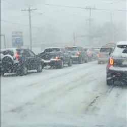 Heavy snow holds up roadways, causing traffic jams