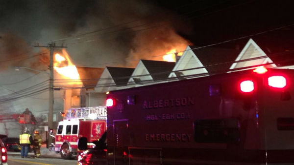 A 4-alarm fire burned through two condos in Albertson.  LIRR service was disrupted and power was cut to the area while firefighters worked. <span class=meta>(@angelesnievas)</span>
