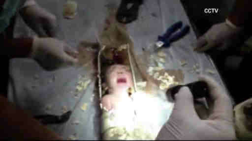 A newborn baby was rescued after being trapped in a drain in China.