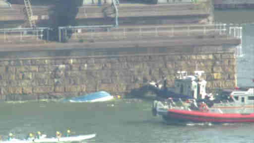 "<div class=""meta image-caption""><div class=""origin-logo origin-image ""><span></span></div><span class=""caption-text"">Three people were rescued after a 25 foot boat capsized in the East River just under the Manhattan Bridge.</span></div>"