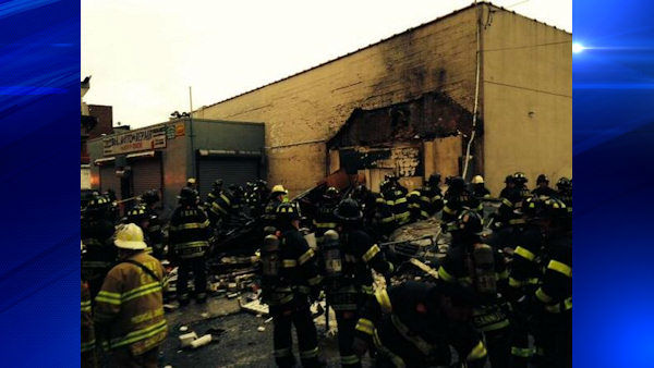 A father and son were seriously injured Wednesday morning in an explosion and collapse of a building they were working in next to a Bronx auto body shop.