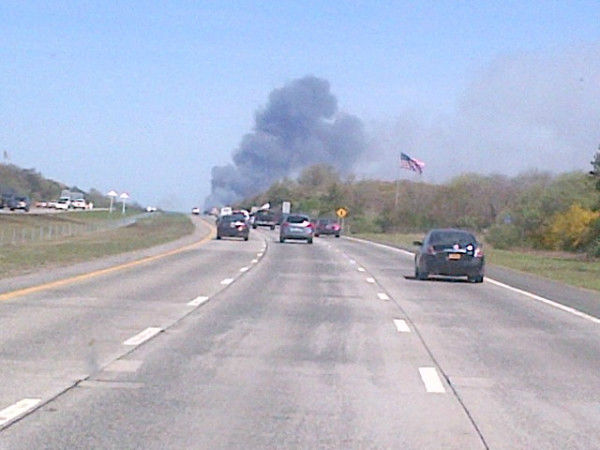 "<div class=""meta ""><span class=""caption-text "">Smoke rising along the Long Island Expressway approaching Manorville on Tuesday, April 17, 2012.  (Josh Einiger)</span></div>"