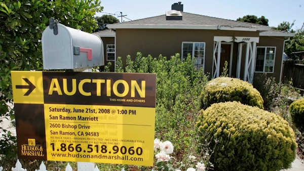 An auction sign is posted at a house under foreclosure in East Palo Alto, Calif., Thursday, June 5, 2008. Home foreclosures and late payments set records over the first three months of the year and are expected to keep rising, stark signs of the housing crisis mounting damage to homeowners and the economy. (AP Photo/Paul Sakuma)