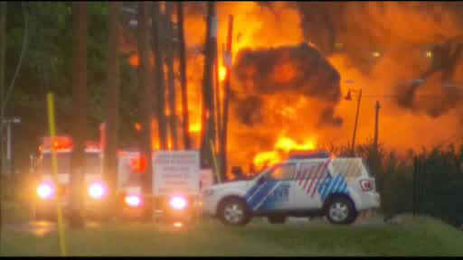 Flames rise from railway cars that were carrying crude oil after derailing in downtown  Lac Megantic, Que., Saturday, July 6, 2013.