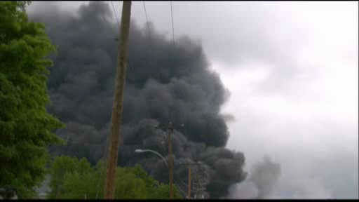 "<div class=""meta ""><span class=""caption-text "">Smoke rises from railway cars that were carrying crude oil after derailing in downtown  Lac Megantic, Que., Saturday, July 6, 2013. </span></div>"