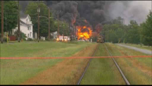 "<div class=""meta image-caption""><div class=""origin-logo origin-image ""><span></span></div><span class=""caption-text"">Flames rise from railway cars that were carrying crude oil after derailing in downtown  Lac Megantic, Que., Saturday, July 6, 2013. </span></div>"