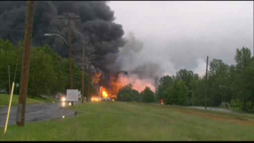 "<div class=""meta image-caption""><div class=""origin-logo origin-image ""><span></span></div><span class=""caption-text"">Smoke rises from railway cars that were carrying crude oil after derailing in downtown  Lac Megantic, Que., Saturday, July 6, 2013. </span></div>"