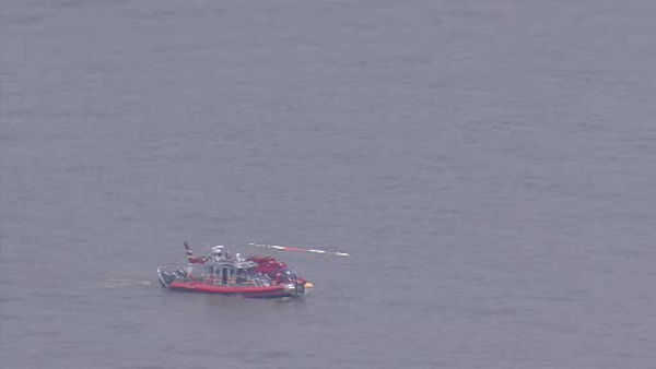 A pilot and four passengers were rescued and taken to shore after a helicopter made a hard landing in the Hudson River Sunday.