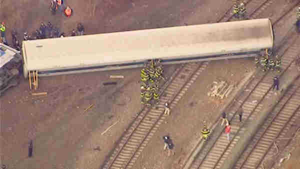 "<div class=""meta image-caption""><div class=""origin-logo origin-image ""><span></span></div><span class=""caption-text"">A Metro-North train derailed in the Bronx Sunday morning, leaving 4 people dead and dozens of others injured.</span></div>"