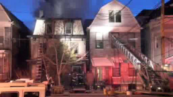 "<div class=""meta ""><span class=""caption-text "">Firefighters battled a three-alarm fire Sunday morning in the Claremont section of the Bronx</span></div>"