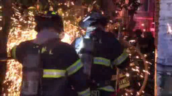 Firefighters battled a three-alarm fire Sunday morning in the Claremont section of the Bronx