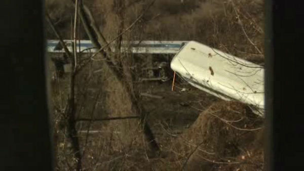 "<div class=""meta ""><span class=""caption-text "">A Metro-North train derailed Sunday morning in the Spuyten Duyvil section of the Bronx, with four cars coming off the tracks and two flipping onto their side.</span></div>"