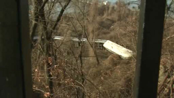 "<div class=""meta image-caption""><div class=""origin-logo origin-image ""><span></span></div><span class=""caption-text"">A Metro-North train derailed Sunday morning in the Spuyten Duyvil section of the Bronx, with four cars coming off the tracks and two flipping onto their side.</span></div>"
