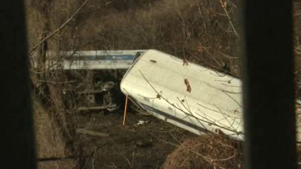 A Metro-North train derailed Sunday morning in the Spuyten Duyvil section of the Bronx, with four cars coming off the tracks and two flipping onto their side.
