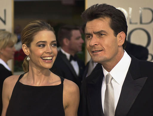 Actor Charlie Sheen, right, of television&#39;s &#34;Spin City,&#34; is joined by fiance and actress Denise Richards, as he arrives at the 59th Annual Golden Globe Awards in Beverly Hills, Calif., Sunday, Jan. 20, 2002. Sheen won an award for best performance by an actor in a television comedy series. &#40;AP Photo&#47;Kevork Djansezian&#41; <span class=meta>(AP Photo&#47; KEVORK DJANSEZIAN)</span>
