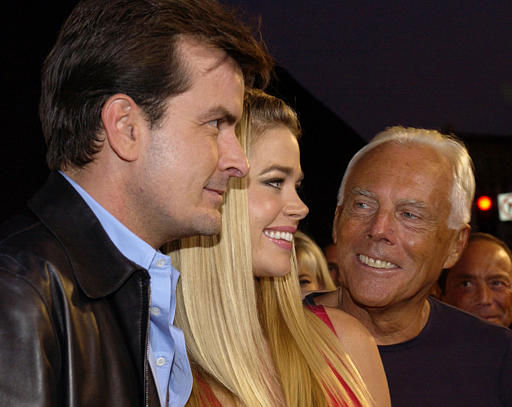 Giorgio Armani, right, poses with Charlie Sheen, left, and Sheen&#39;s wife, Denise Richards, as they arrive for the fashion show and award ceremony to honor Armani with the inaugural &#34;Rodeo Drive Walk of Style&#34; award Tuesday, Sept. 9, 2003, in the Beverly Hills section of Los Angeles. &#40;AP Photo&#47;Chris Weeks&#41; <span class=meta>(AP Photo&#47; CHRIS WEEKS)</span>