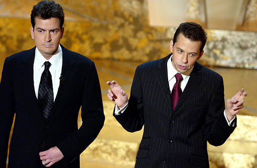 Actors Charlie Sheen, left and Jon Cryer open the show at the 30th Annual People&#39;s Choice Awards Sunday, Jan. 11, 2004, in Pasadena, Calif. Sheen says he&#39;s having fun portraying a G-rated version of his former self on the CBS comedy, &#34;Two and Half Men.&#39;&#39;&#40;AP Photo&#47;Mark J. Terrill&#41; <span class=meta>(AP Photo&#47; MARK J. TERRILL)</span>