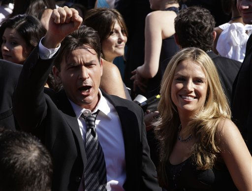 "<div class=""meta image-caption""><div class=""origin-logo origin-image ""><span></span></div><span class=""caption-text"">Actor Charlie Sheen and his fiance Brooke Mueller arrives at the 59th Primetime Emmy Awards Sunday, Sept. 16, 2007, at the Shrine Auditorium in Los Angeles.  (AP Photo/Kevork Djansezian) (AP Photo/ Kevork Djansezian)</span></div>"