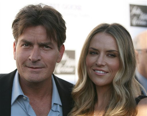 Actor Charlie Sheen, left, and Brooke Wolofsky arrives at the 7th Annual Chrysalis Butterfly Ball on Saturday, May 31, 2008, in Los Angeles. (AP Photo/Chris Weeks)