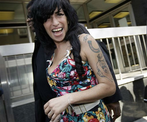 "<div class=""meta ""><span class=""caption-text "">British Singer Amy Winehouse leaves the City of Westminster Magistrates Court in west London, Tuesday, March 17, 2009, where she faces a charge of common assault over an incident at a charity ball.  Winehouse, 25, is accused of assaulting a woman in London's Berkeley Square on Sept. 26, 2008. (AP Photo/Joel Ryan) (AP Photo/ Joel Ryan)</span></div>"