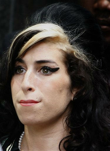 "<div class=""meta ""><span class=""caption-text "">British singer Amy Winehouse leaves Westminster magistrates court in London, Friday, July 24, 2009. The singer was found not guilty of assault. (AP Photo/Kirsty Wigglesworth) (AP Photo/ Kirsty Wigglesworth)</span></div>"