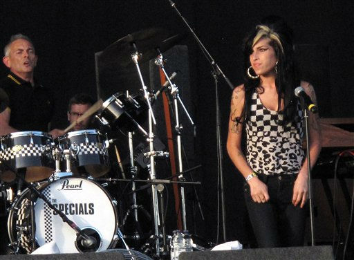 British singer Amy Winehouse performs with British band The Specials for a rendition of 'Ghost Town' at the V Festival in Chelmsford, England on Saturday, August 22, 2009. (AP Photo/Joel Ryan)