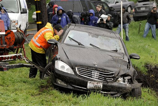 A tow truck operator inspects actor Charlie Sheen&#39;s Mercedes after it was towed out of a ravine, found overturned hundreds of feet down a cliff near his home early Friday, Feb. 5, 2010, in the Sherman Oaks area of Los Angeles. &#40;AP Photo&#47;Gus Ruelas&#41; <span class=meta>(AP Photo&#47; Gus Ruelas)</span>