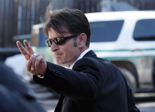 "<div class=""meta image-caption""><div class=""origin-logo origin-image ""><span></span></div><span class=""caption-text"">His wedding band still on his ring finger, television situation comedy show star Charlie Sheen exits Pitkin County Courthouse in Aspen, Colo., on Monday, March 15, 2010, after pleading not guilty on domestic violence charges stemming from a Christmas Day dispute with his wife. Sheen entered a plea of not guilty to charges of menacing, criminal mischief and assault for the incident.  (AP Photo/David Zalubowski) (AP Photo/ David Zalubowski)</span></div>"