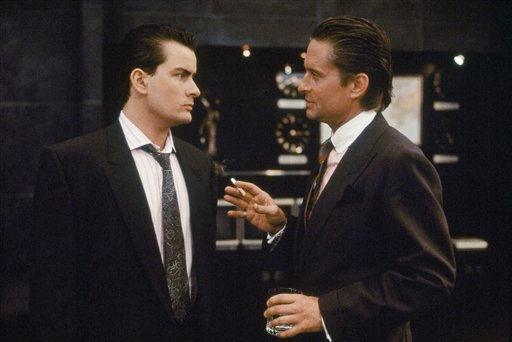 FILE - In this 1987 film publicity image originally released by 20th Century Fox, Charlie Sheen, left, and Michael Douglas are shown in a scene from, &#34;Wall Street.&#34;  &#40;AP Photo&#47;20th Century Fox&#41; <span class=meta>(AP Photo&#47; Anonymous)</span>