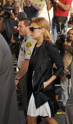 "<div class=""meta ""><span class=""caption-text "">Lindsay Lohan arrives for a hearing at the Beverly Hills Courthouse in Beverly Hills, Calif., Friday, Sept. 24, 2010.  (AP Photo/ Chris Pizzello)</span></div>"