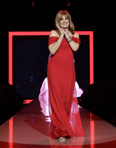 "<div class=""meta image-caption""><div class=""origin-logo origin-image ""><span></span></div><span class=""caption-text"">Actress Linda Gray walks the runway wearing a dress designed by Pamella Roland during the Heart Truth Red Dress Fall 2011 show in New York, Wednesday, Feb. 9, 2011.  (AP Photo/Kathy Willens) (AP Photo/ Kathy Willens)</span></div>"