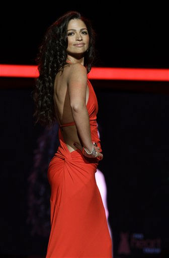 "<div class=""meta image-caption""><div class=""origin-logo origin-image ""><span></span></div><span class=""caption-text"">Camila Alves walks the runway wearing a dress designed by Kaufman Franco during the Heart Truth Red Dress Fall 2011 show in New York, Wednesday, Feb. 9, 2011.  (AP Photo/Kathy Willens) (AP Photo/ Kathy Willens)</span></div>"