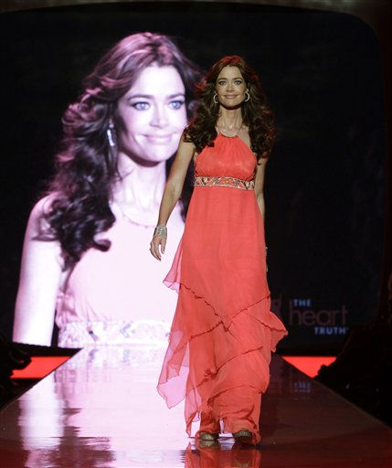 "<div class=""meta image-caption""><div class=""origin-logo origin-image ""><span></span></div><span class=""caption-text"">Denise Richards walks the runway wearing a dress designed by Matthew Willaimson during the Heart Truth Red Dress Fall 2011 show in New York, Wednesday, Feb. 9, 2011.  (AP Photo/Kathy Willens) (AP Photo/ Kathy Willens)</span></div>"