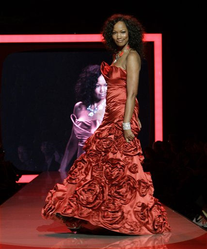 "<div class=""meta image-caption""><div class=""origin-logo origin-image ""><span></span></div><span class=""caption-text"">Garcelle Beauvais walks the runway wearing a dress designed by Monique Lhuiller during the Heart Truth Red Dress Fall 2011 show in New York, Wednesday, Feb. 9, 2011.  (AP Photo/Kathy Willens) (AP Photo/ Kathy Willens)</span></div>"