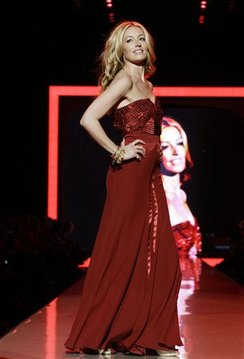 "<div class=""meta image-caption""><div class=""origin-logo origin-image ""><span></span></div><span class=""caption-text"">Cat Deeley walks the runway wearing a dress designed by Alberta Ferretti during the Heart Truth Red Dress Fall 2011 show in New York, Wednesday, Feb. 9, 2011.  (AP Photo/Kathy Willens) (AP Photo/ Kathy Willens)</span></div>"