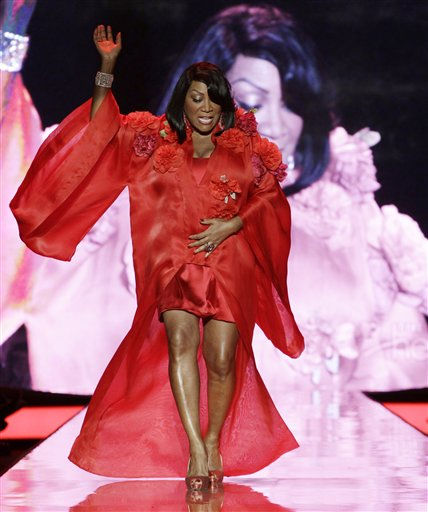 "<div class=""meta image-caption""><div class=""origin-logo origin-image ""><span></span></div><span class=""caption-text"">Patti LaBelle walks the runway wearing a dress designed by Zang Toi during the Heart Truth Red Dress Fall 2011 show in New York, Wednesday, Feb. 9, 2011.  (AP Photo/Kathy Willens) (AP Photo/ Kathy Willens)</span></div>"