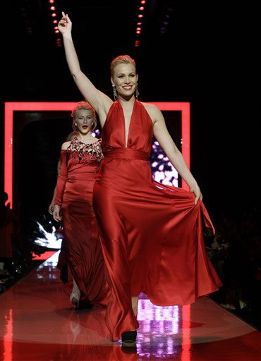 "<div class=""meta image-caption""><div class=""origin-logo origin-image ""><span></span></div><span class=""caption-text"">Natasha Bedingfield walks the runway wearing a dress designed by Nicole Miller followed by Julianne Hough, left, in Swarovski during the Heart Truth Red Dress Fall 2011 show in New York, Wednesday, Feb. 9, 2011.  (AP Photo/Kathy Willens) (AP Photo/ Kathy Willens)</span></div>"