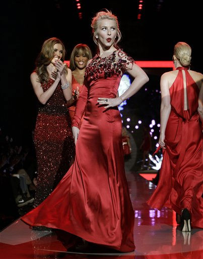 "<div class=""meta image-caption""><div class=""origin-logo origin-image ""><span></span></div><span class=""caption-text"">Julianne Hough, center, walks the runway wearing Swarovski  with others following during the Heart Truth Red Dress Fall 2011 show in New York, Wednesday, Feb. 9, 2011.  (AP Photo/Kathy Willens) (AP Photo/ Kathy Willens)</span></div>"